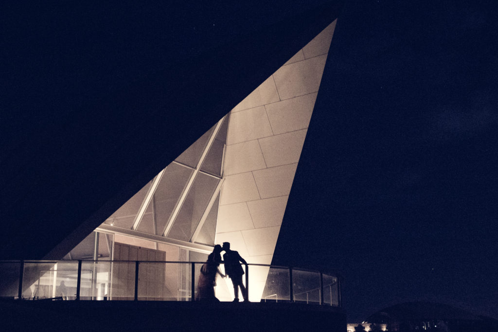 silhouette of wedding couple kissing at national arboretum canberra